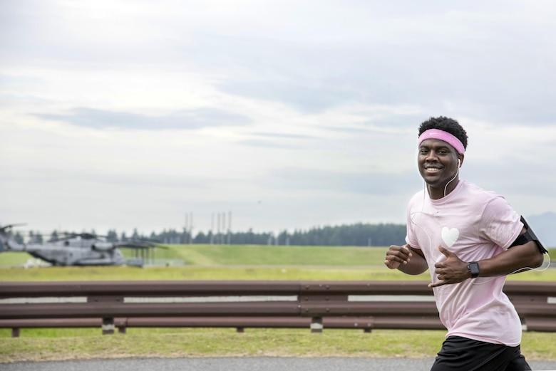 A participant runs during the Breast Cancer Awareness Month 5K run at Yokota Air Base, Japan, Oct. 06, 2017.
