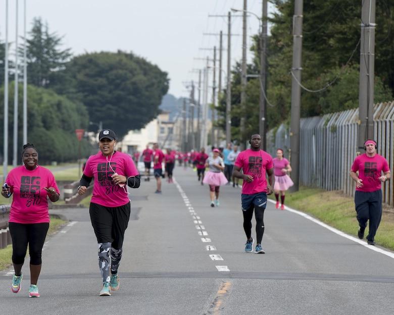 Participants run during the Breast Cancer Awareness Month 5K run at Yokota Air Base, Japan, Oct. 06, 2017.