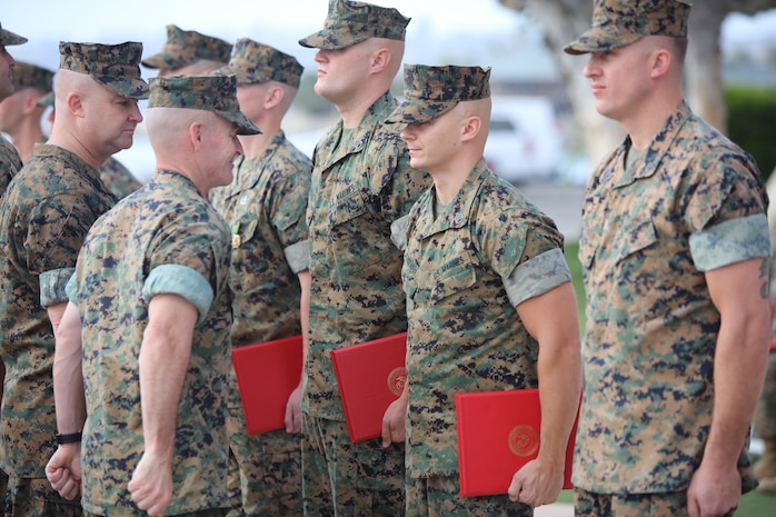Colonel David M. Fallon, the 9th Marine Corps District commanding officer, presents awards to Marines during the Operation Herculean Effort ceremony in San Diego, Calif., Oct. 11. The ceremony was conducted in order to recognize the Marine recruiters from the 9th MCD, who went above and beyond in finding the most highly qualified men and women to join its ranks during the two-month recruiting offensive. Marines received awards, such as the Navy and Marine Corps Commendation and the Navy and Marine Corps Achievement Medals. (U.S. Marine Corps photo by Lance Cpl. Quavaungh Pointer)