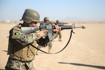 An Afghan National Army soldier with 6th Kandak, 1st Brigade, 215th Corps executes an immediate action drill during a mock patrol at Camp Shorabak, Afghanistan, Oct. 15, 2017. More than 300 soldiers with the unit are currently conducting an eight-week operational readiness cycle at the Helmand Regional Military Training Center. Led by ANA instructors with assistance from U.S. Marine advisors from Task Force Southwest, the ORC is designed to enhance the soldiers' infantry tactics and techniques in preparation for future combat operations against the Taliban. (U.S. Marine Corps photo by Sgt. Lucas Hopkins)