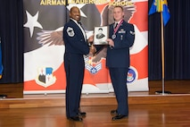 U.S. Air Force Staff Sgt. Zachariah Mick, 52nd Maintenance Squadron munitions controller, receives the John L. Levitow during the Pitsenbarger Airman Leadership School 17-G graduation at Club Eifel on Spangdahlem Air Base, Germany, October 12, 2017. The Levitow award is the highest honor given to the student who displays excellence in all categories of ALS. (U.S. Air Force photo by Senior Airman Dawn M. Weber)