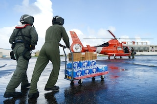 Coast Guard aircrew delivers food and water to residents in need of aid in Jayuya, Puerto Rico, Oct. 14, 2017. Coast Guard photo by Senior Chief Petty Officer Kyle Niemi