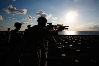 Marines assigned to the 15th Marine Expeditionary Unit's Battalion Landing Team, 1st Battalion, 5th Marine Regiment, fire at targets during a deck shoot aboard the San Antonio-class amphibious transport dock ship USS San Diego, Oct. 11, 2017. The 15th MEU perform deck shoots to remain proficient with their weapons and be prepared as a maritime crisis-contingency force. San Diego is deployed with the America Amphibious Ready Group and 15th MEU to support maritime security operations and theater security cooperation efforts in the U.S. 6th Fleet area of operations.