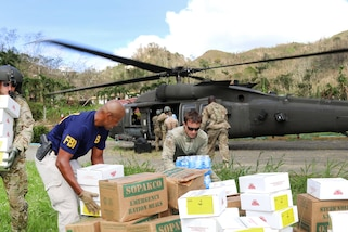 Soldiers deliver food and water to residents at locations throughout the rural, isolated areas of Puerto Rico, Oct. 14, 2017. Army photo by Capt. Tyson Friar