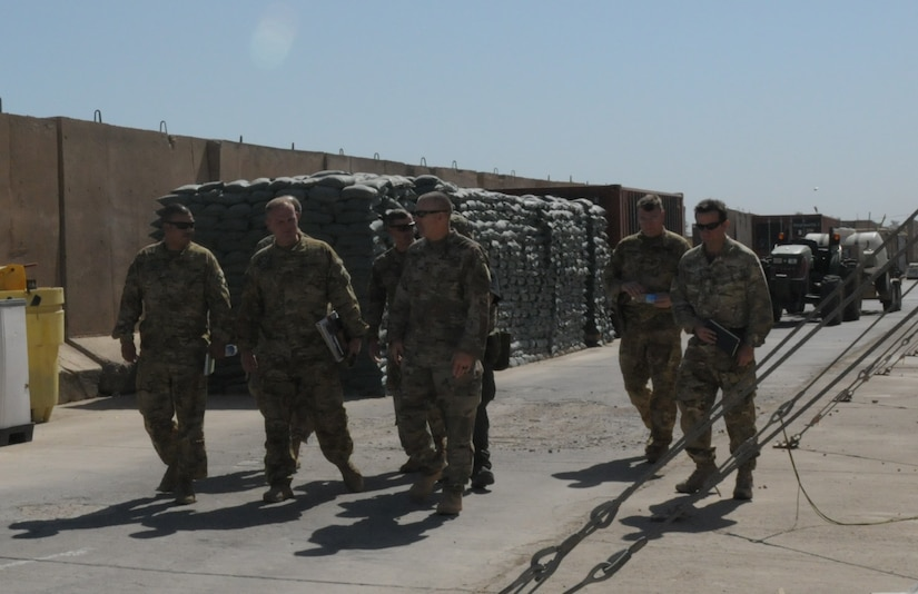 Group of Soldiers walking through the military complex.