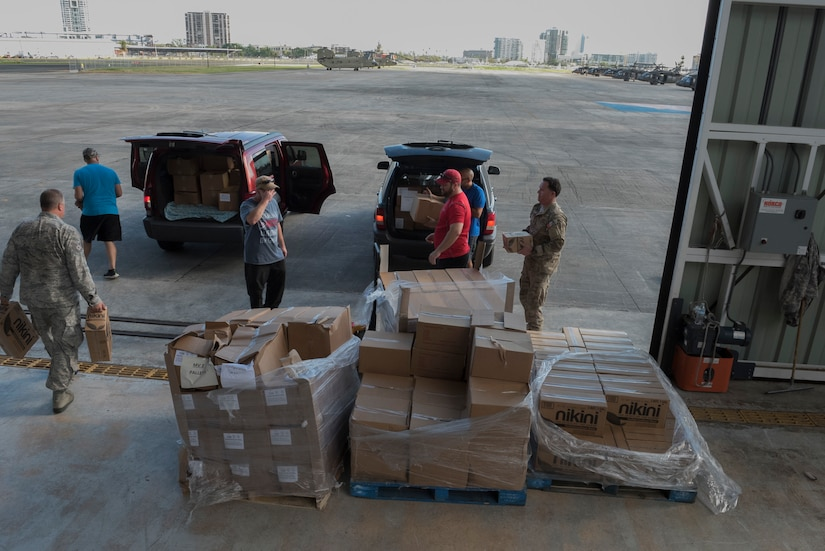 Airmen from the Puerto Rico Air National Guard use their day off to partner with volunteers from the Foundation for Puerto Rico in support of Hurricane Maria relief efforts and load vehicles with food and water for delivery to Orocovis National Guard Army Aviation Facility in San Juan, Puerto Rico, Oct. 13, 2017. Air National Guard photo by Staff Sgt. Michelle Y. Alvarez-Rea