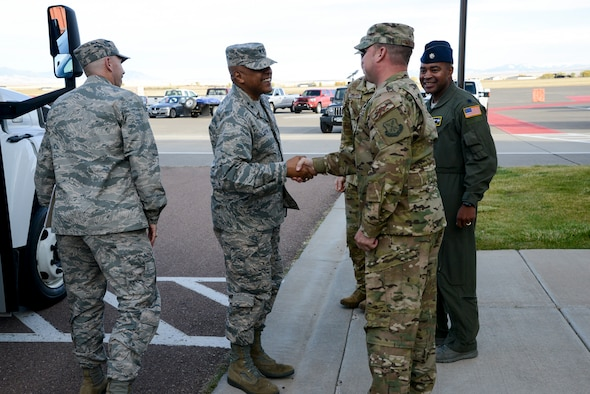 Maj. Gen. Anthony Cotton, 20th Air Force commander, shakes hands with Senior Master Sgt. Shawn Watkins, 40th Helicopter Squadron superintendent, upon his arrival to the 40th HS, Oct. 10, 2017 at Malmstrom Air Force Base, Mont.