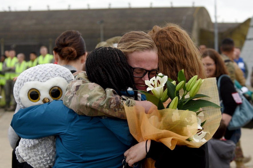 A 48th Fighter Wing Airman returns to Royal Air Force Lakenheath, England, Oct. 11, following a deployment. F-15E Strike Eagles and Airmen from the 492nd Fighter Squadron and supporting units across the 48th Fighter Wing returned from a six-month deployment to an undisclosed location in Southwest Asia. (U.S. Air Force photo/Airman 1st Class John A. Crawford)