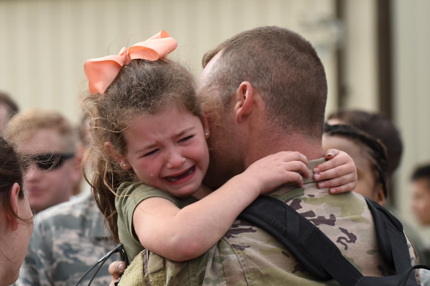 A 48th Fighter Wing Airman embraces a family member at Royal Air Force Lakenheath, England, after returning from a deployment Oct. 11. F-15E Strike Eagles and Airmen from the 492nd Fighter Squadron and supporting units across the 48th Fighter Wing returned from a six-month deployment to an undisclosed location in Southwest Asia. (U.S. Air Force photo/Airman 1st Class Eli Chevalier)