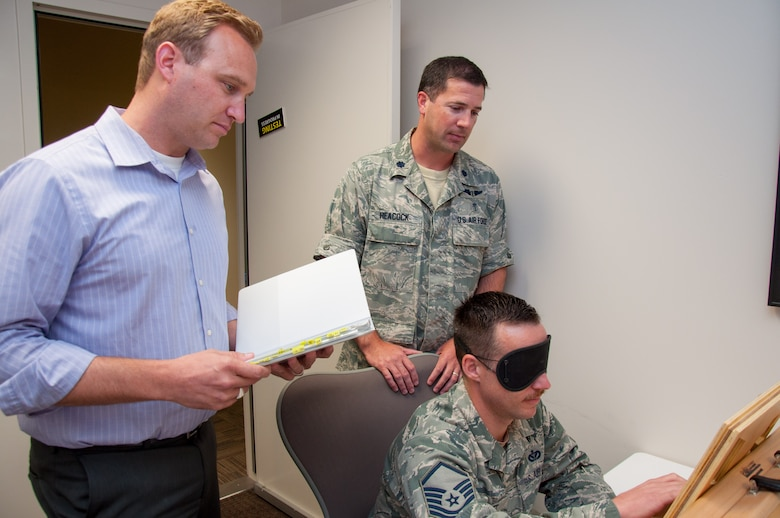 John Heaton (left), Neuropsychiatry Branch manager of the Aeromedical Consultation Service, and Lt. Col. Kevin Heacock, ACS Neuropsychiatry Branch chief, oversee a demonstration of a psychological test on Master Sgt.Walter Croft, the branches NCO in charge and mental health technician. The test is one of several that are administered to waiver candidates to evaluate cognitive functioning. (The test is not revealed here in order to not compromise its effectiveness in the future). (U.S. Air Force photo/John Harrington)