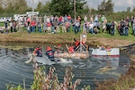 Associates surrounded the Eagle Eye Golf Course pond to watch teams compete in the 3rd Annual Cardboard Regatta
