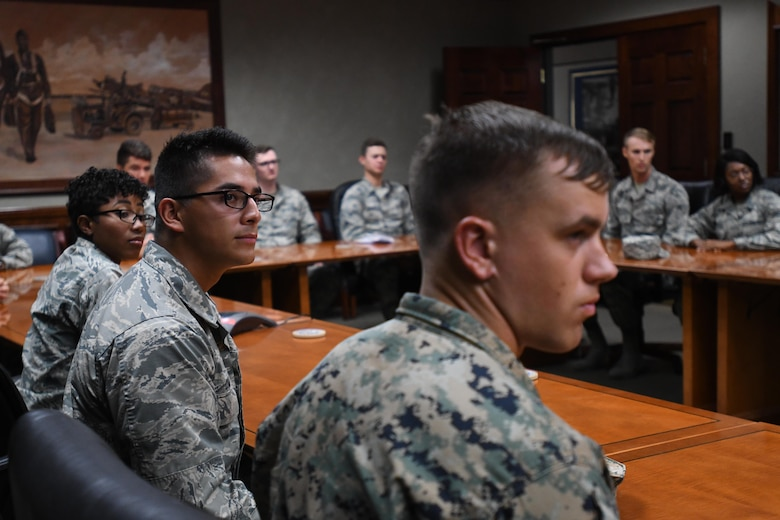 335th Training Squadron weather students attend a video teleconference with Lt. Gen. Richard Clark, 3rd Air Force commander, Ramstein Air Base, Germany, at Stennis Hall Oct. 12, 2017, on Keesler Air Force Base, Mississippi. Airmen delivered a mission and regional weather forecast to Clark as a training demonstration as well as a mentorship opportunity. (U.S. Air Force photo by Kemberly Groue)