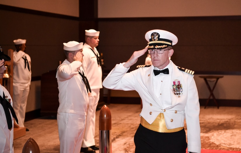 Capt. Robert E. Hudson Deputy Commander, Joint Base Charleston and Commanding Officer, Naval Support Activity Charleston, salutes the Side Boys as he enters the Navy's 242nd birthday ball in Charleston, S.C., Oct. 14, 2017.
