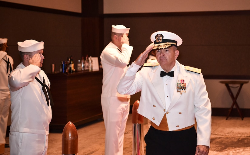 Rear Adm. Jeff Tussler, director of future plans at the Office of the Chief of Naval Operations, salutes the side boys as he enters the Navy's 242nd birthday ball in Charleston, S.C., Oct. 14, 2017.