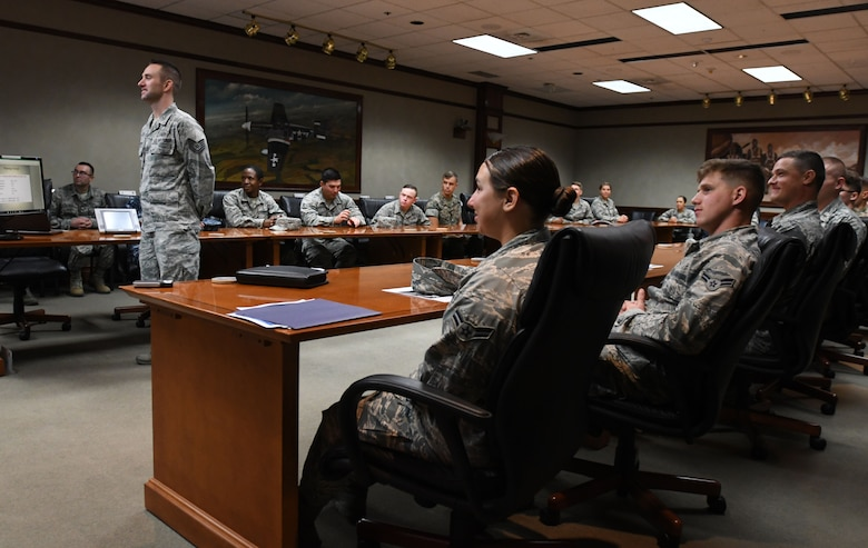 Tech. Sgt. Zachary Ferguson, 335th Training Squadron instructor supervisor, delivers comments to Lt. Gen. Richard Clark, 3rd Air Force commander, Ramstein Air Base, Germany, via a video teleconference at Stennis Hall Oct. 12, 2017, on Keesler Air Force Base, Mississippi. Ferguson's students delivered a mission and regional weather forecast as a training demonstration as well as a mentorship opportunity. (U.S. Air Force photo by Kemberly Groue)