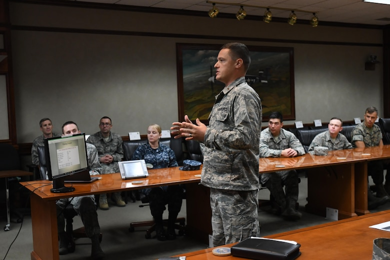 Second Lt. James Merritt, 335th Training Squadron student, delivers a mission and regional weather forecast to Lt. Gen. Richard Clark, 3rd Air Force commander, Ramstein Air Base, Germany, via a video teleconference at Stennis Hall Oct. 12, 2017, on Keesler Air Force Base, Mississippi. Merritt, accompanied by fellow students, delivered the forecast as a training demonstration as well as a mentorship opportunity. (U.S. Air Force photo by Kemberly Groue)