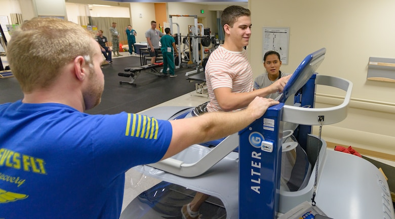Jack Camoratto, brother of Dr. Joseph Camoratto, 81st Surgical Operations Squadron doctor of physical therapy, runs on the Anti-Gravity treadmill as Daniel Roquemore and Jaymee Cruz, 81st Surgical Operations Squadron physical therapy students, look on at the Physical and Occupational Therapy clinic open house Oct. 13, 2017, on Keesler Air Force Base, Mississippi. The event was held in celebration of National Physical Therapy and Chiropractic Month and housed several demonstrations to include dry needling, anti-gravity treadmill and power lifting techniques. (U.S. Air Force photo by Andre' Askew)
