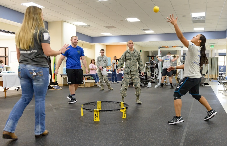 Keesler personnel test their range of motion by playing a game at the Physical and Occupational Therapy clinic open house Oct. 13, 2017, on Keesler Air Force Base, Mississippi. The event was held in celebration of National Physical Therapy and Chiropractic Month and housed several demonstrations to include dry needling, anti-gravity treadmill and power lifting techniques. (U.S. Air Force photo by Andre' Askew)