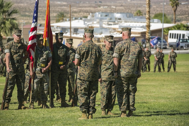 Sgt. Maj. Avery Crespin,former Headquarter Battalion sergeant major, receives a meritorious service medal during his retirement ceremony at Lance Cpl. Torrey L. Gray field aboard the Combat Center, September 29, 2017. Crespin served in more than five units and Military Occupational Specialties during  his 22 years of active duty service. (U.S. Marine Corps photo by Lance Cpl. Isaac Cantrell)