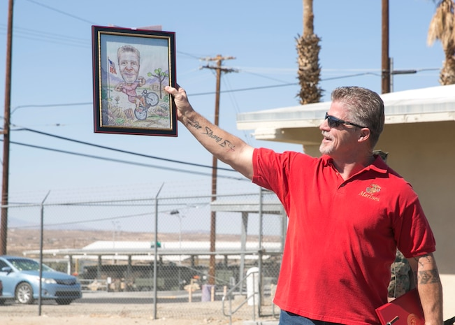 Michael Ray, a worker with Public Works Division, shows off a gift from his coworkers during an award ceremony at the Public Works Division Compound aboard the Marine Corps Air Ground Combat Center, Twentynine Palms, Calif., October 10, 2017. Ray received the gift from his coworkers to show their appreciation for his hard work and dedication to his career. (U.S. Marine Corps photo by Lance Cpl. Isaac Cantrell)