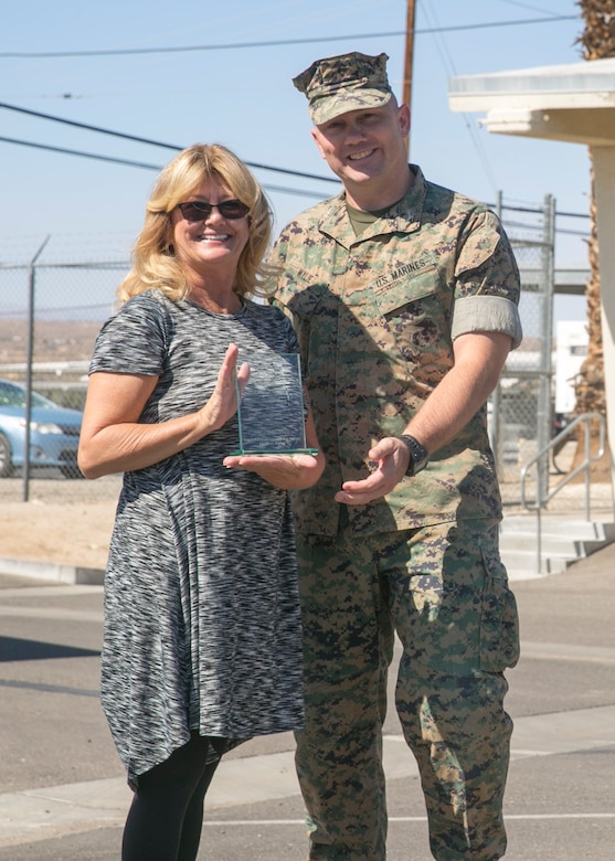 Col. Jay Wylie, assistant chief of staff, Installation Support Directorate, presents Vickie Hatch, a worker with Public Works Division, a support excellence award during an award ceremony at the Public Works Division Compound aboard the Marine Corps Air Ground Combat Center, Twentynine Palms, Calif., October 10, 2017. Hatch received the award for her hard work and dedication to PWD and the Combat Center. (U.S. Marine Corps photo by Lance Cpl. Isaac Cantrell)