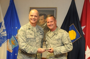 Maj. Gen. Ronald Paul presents recruiting awards to Illinois Air National Guard recruiters.