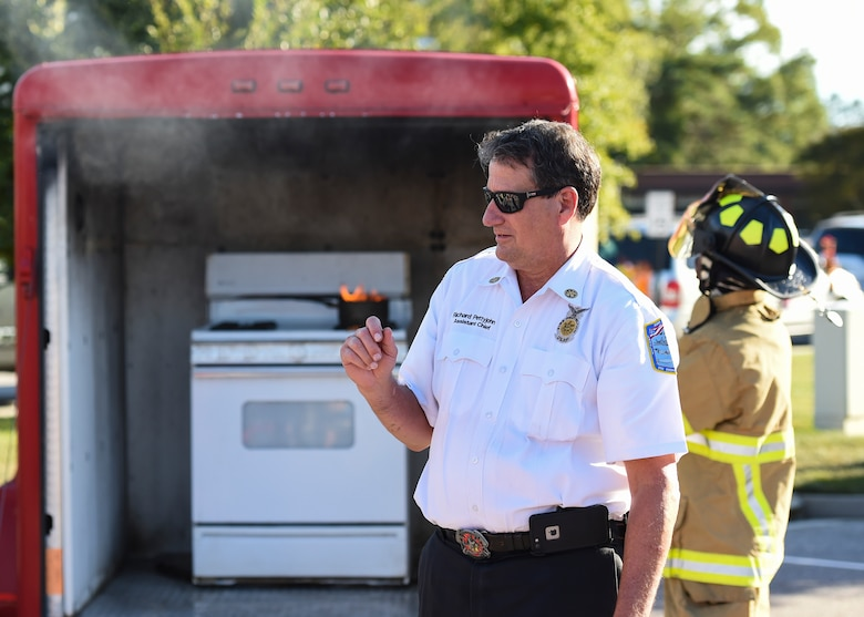 Richard Pettyjohn, 633rd Civil Engineer Squadron Fire Department assistant chief, prepares attendees for a kitchen fire display at Bethel Manor Housing, Yorktown, Va., Oct. 6, 2017.