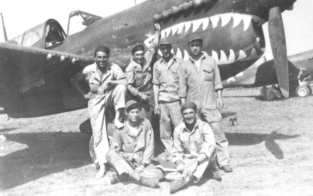 A group of 33rd Fighter Group members gather in front of a P-40 Warhawk. (Courtesy Photo)