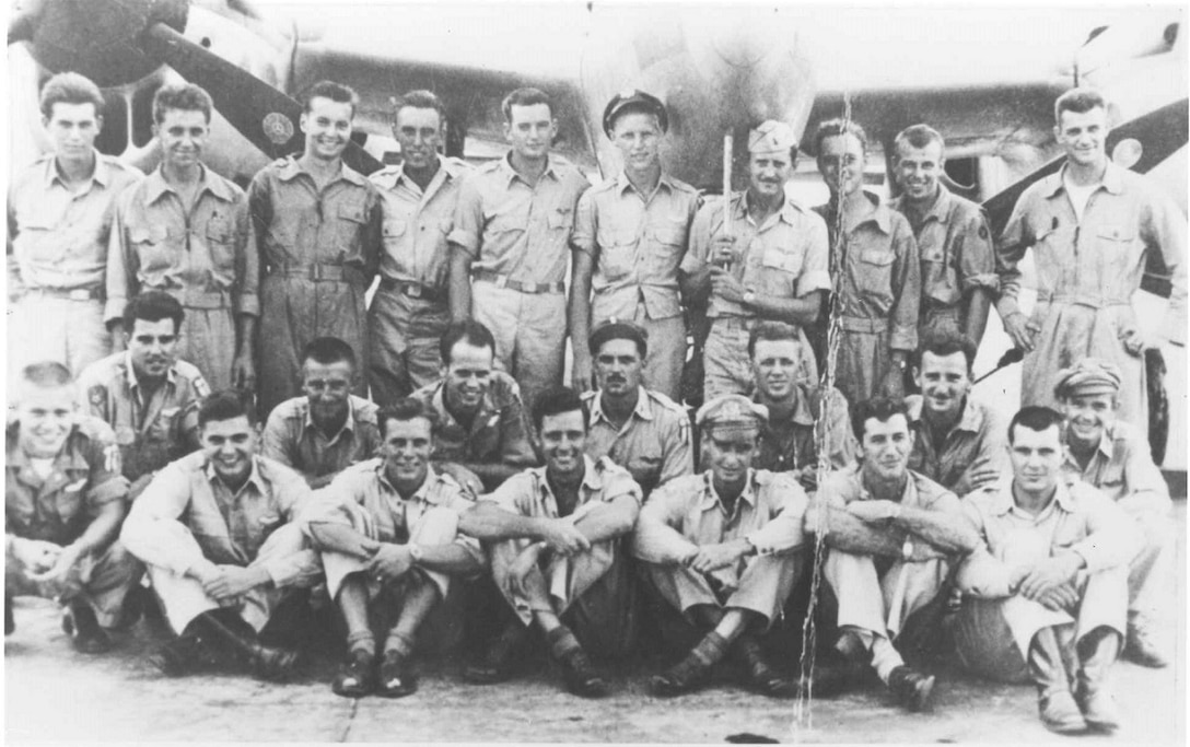 Members of the 33rd Fighter Group in front of a P-38 Lightning at Dudcundy Airfield, India, circa 1945. (Courtesy Photo)
