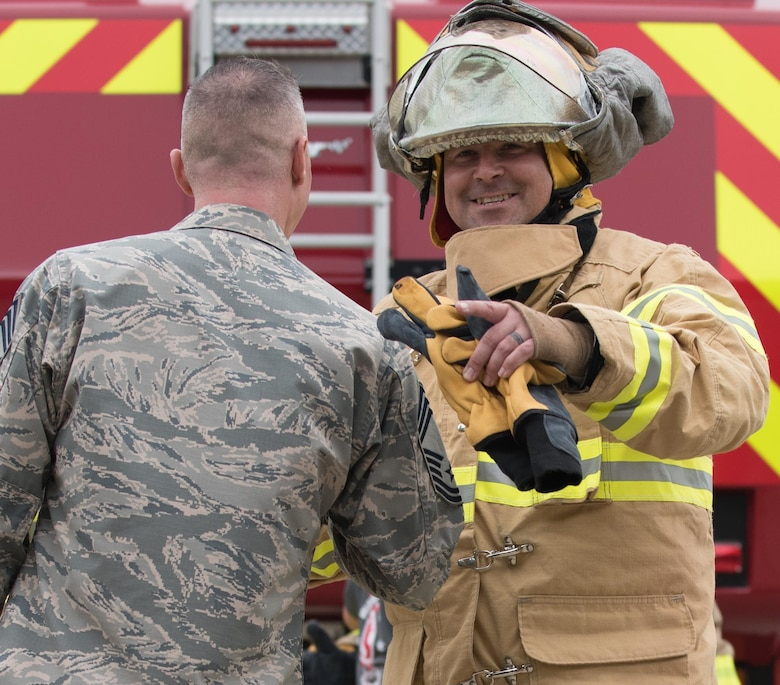 U.S. Air Force Chief Master Sgt. Matthew Mancill, Firefighter Combat Challenge 633rd Mission Support Group team member, celebrates after completing the challenge at Joint Base Langley-Eustis, Va., Oct. 13, 2017.