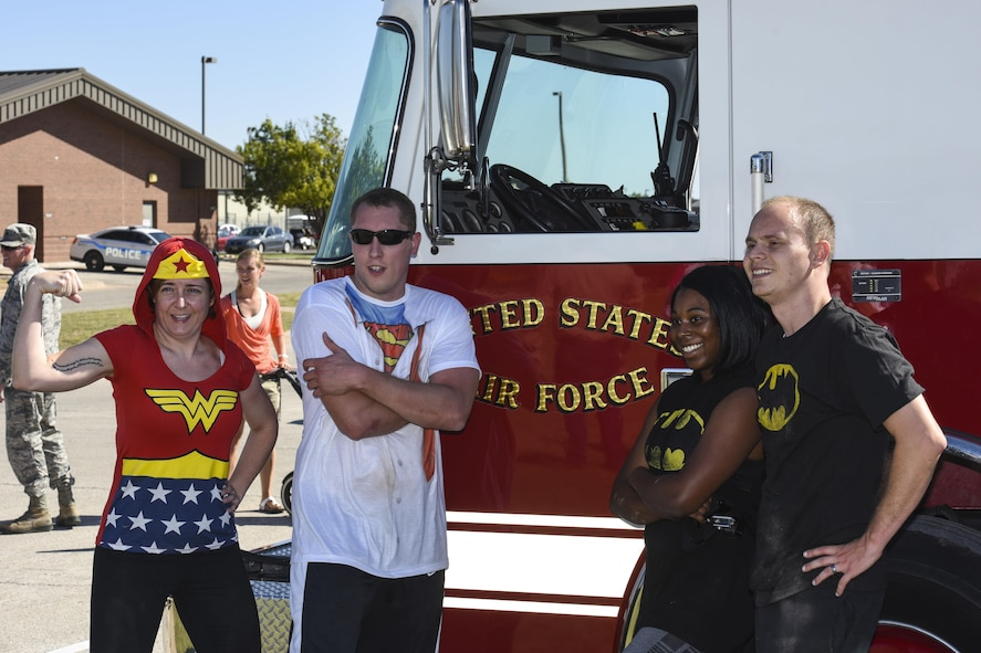 The 17th Training Wing Public Affairs team, consisting of Master Sgt. Joy Meek, superintendent, Staff Sgt. Anthony Hetlage, broadcast journalist journeyman, 1st Lt. Tisha Wilkerson, media operations, and James Orlando, visual information specialist, pose after completing the Fire Muster Challenge beside the Fire Department on Goodfellow Air Force Base, Texas Oct. 13, 2017. The Fire Muster Challenge tested a team's strength and ability to work together. (U.S. Air Force photo by Airman 1st Class Zachary Chapman/Released)