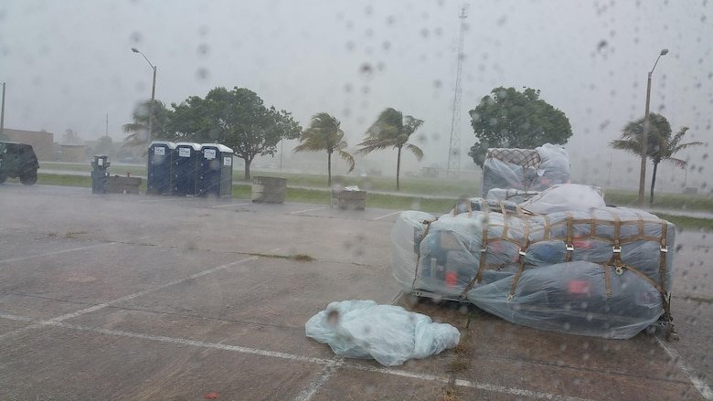 Rain and wind pelts the annual tour worksite of the 35th Combat Communications Squadron at Homestead Air Reserve Base, Florida, during south Florida's wettest week in 26 years.