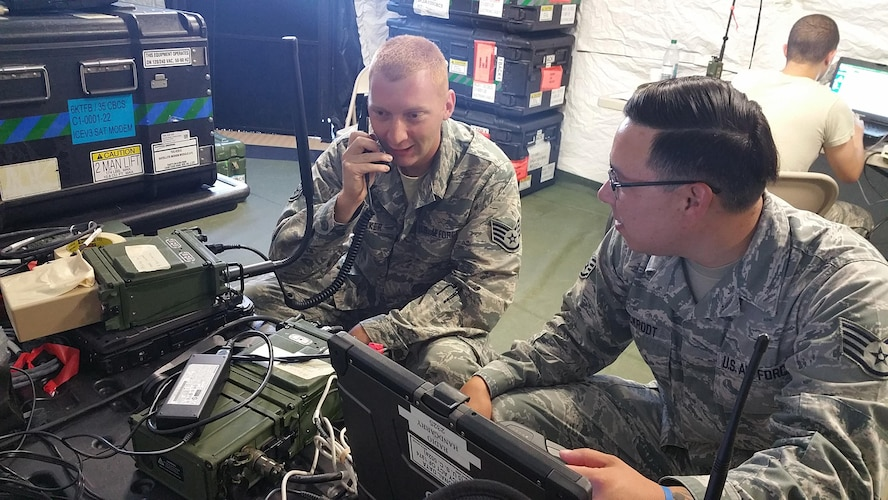 Staff Sgts. Bobby Speaker, left, and Dean Pickrodt, both radio frequency transmissions craftsmen, test tactical radio advanced repeater network functionality in a simulated deployed environment during their annual tour earlier this summer at Homestead Air Reserve Base, Florida.