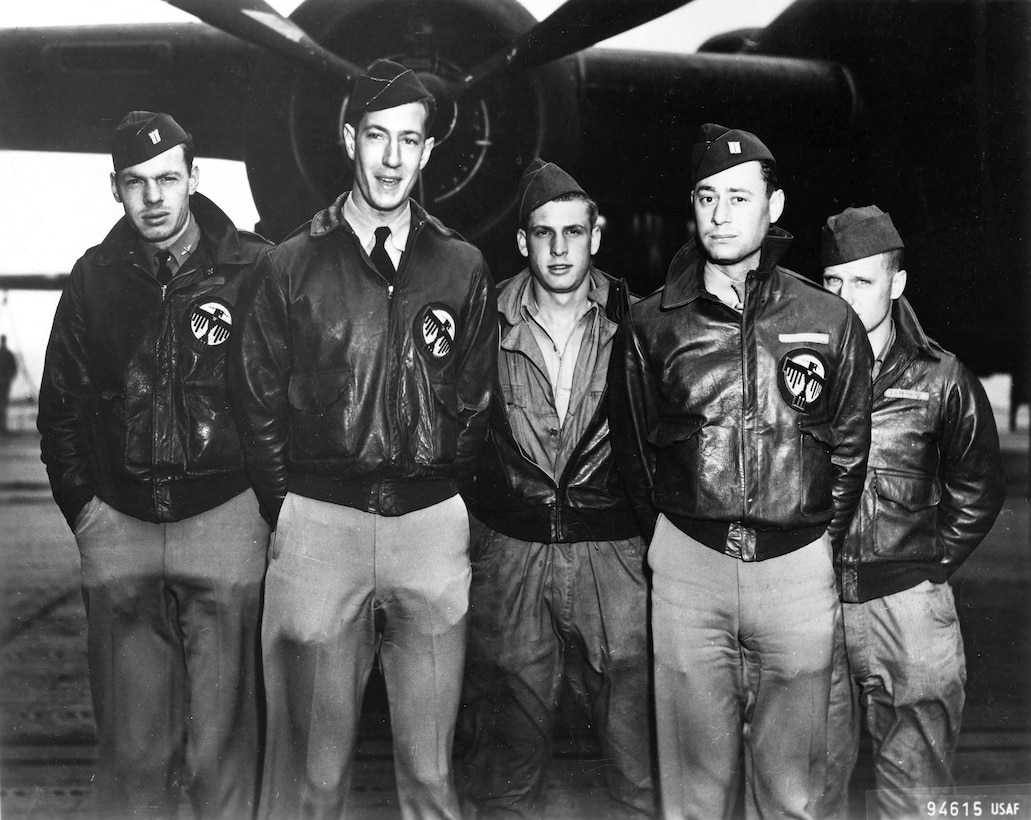 Bill Farrow, second from left, with his crew aboard the USS Hornet. The patches on their A-2 jackets are from the 34th Bomb Squadron, a component of the 17th Bomb Group. (Courtesy photo)