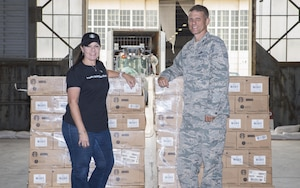 433rd Airlift Wing members seperate flavors of coffee from one of 7 pallets that were donatd to the Alamo Wing,  October 10, 2017 at Joint Base San Antonio-Lackland, Texas.