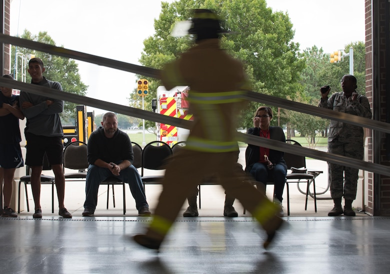 A participant competes in the ladder carry obstacle during the Firefighter Combat Challenge at Joint Base Langley-Eustis, Va., Oct. 13, 2017.