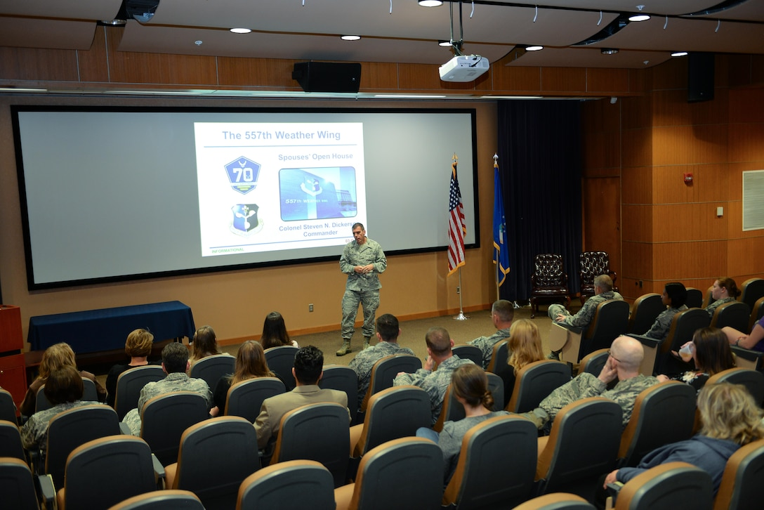 Col. Steven N. Dickerson, commander of the 557th Weather Wing, gives a mission brief to service members and spouses at the Spouses' Event held by the wing at Offutt Air Force Base, Nebraska, Oct. 3, 2017. The event was designed to give spouses a deeper understanding of the weather mission.