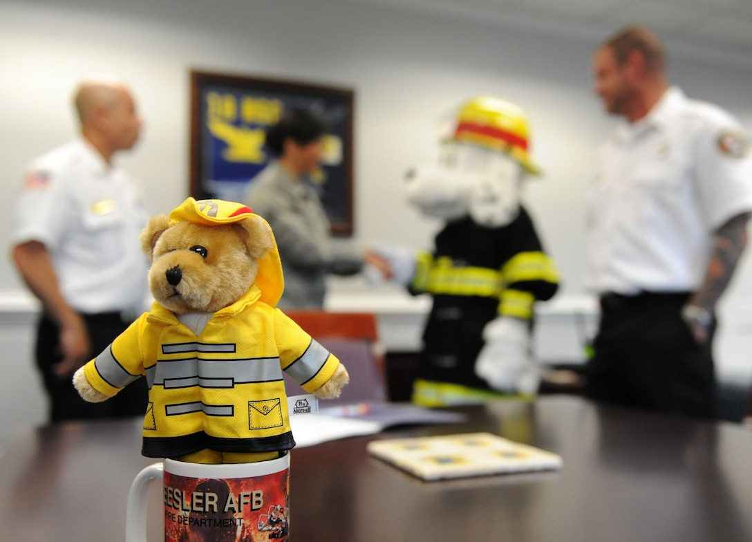 A Keesler Fire Department toy sits on display at the 81st Training Wing headquarters building during Fire Prevention Week kick off Oct. 10, 2017, on Keesler Air Force Base, Mississippi. The week-long event includes fire drills, literature handouts, stove fire demonstrations around the base and concludes with an open house at the fire department Oct. 14. (U.S. Air Force photo by Kemberly Groue)