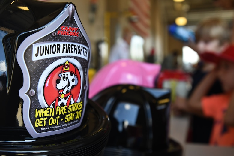 Plastic firefighter hats are on display at the Keesler Fire Department open house at the fire station Oct. 14, 2017, on Keesler Air Force Base, Mississippi. The open house was the concluding event to Fire Prevention Week. Throughout the week the Keesler Fire Department conducted random fire drills, toured various facilities with Sparky the Fire Dog, passed out fire safety information and fire hats for children and provided stove and fire extinguisher demonstrations. (U.S. Air Force photo by Kemberly Groue)