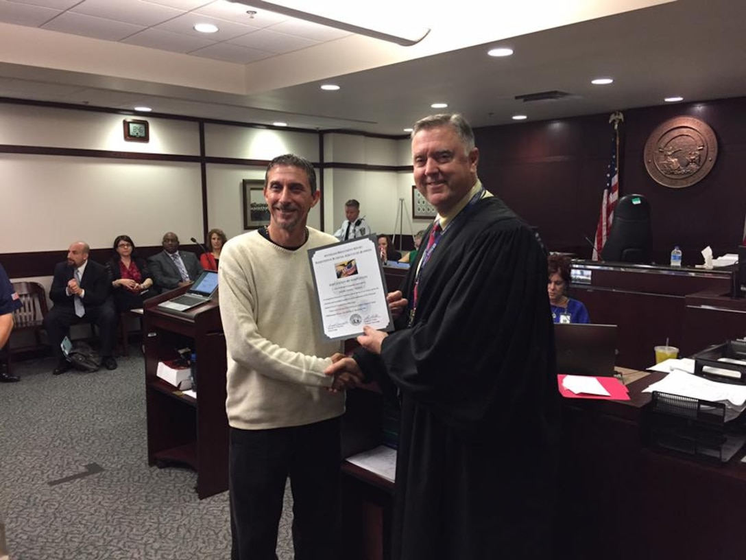 Joseph Stickle (left) and Judge Greg Holder (right) following Stickle's graduation from the Veterans Treatment Court.