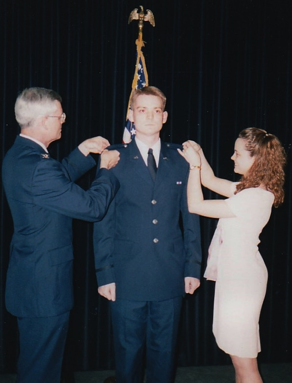 Col. David Miller, 341st Maintenance Group commander, center, pins on the rank of second lieutenant in 1998.