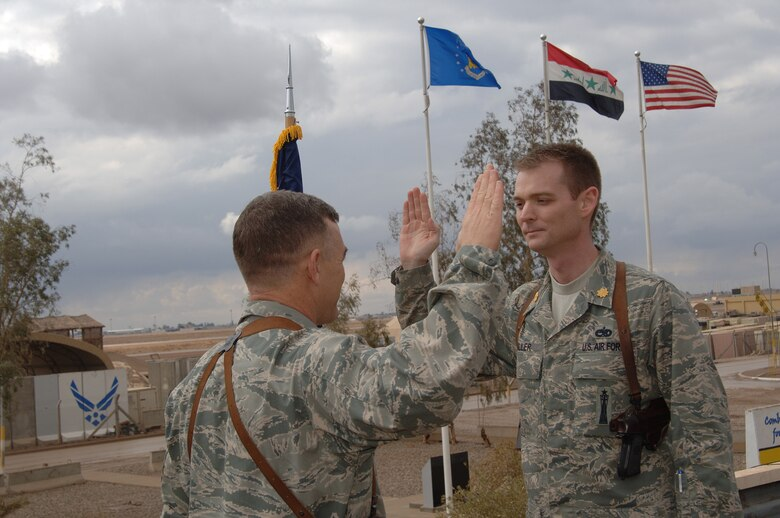 Then Maj. David Miller recites the oath of office during a ceremony after pinning on the rank of major at Balad Air Base, Iraq, in 2008.
