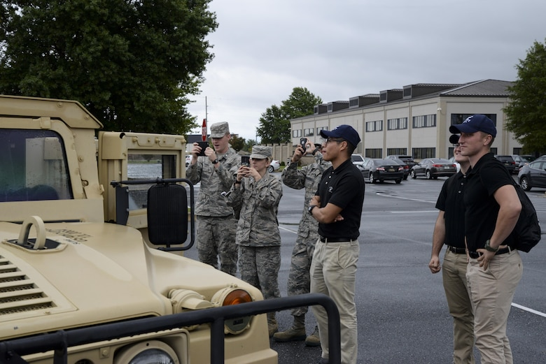 Several ROTC and Junior ROTC cadets take pictures of a 436th Civil Engineer Squadron explosive ordnance disposal vehicle Oct. 11, 2017, during a Pathways to Blue tour at Dover Air Force Base, Del. The cadets learned about practical military organization and how officers fit into the fabric that makes up military units. (U.S. Air Force photo by Staff Sgt. Aaron J. Jenne)