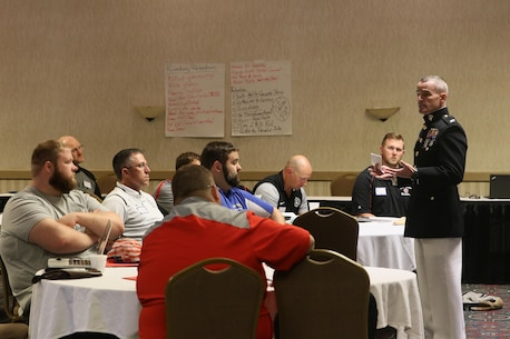 Colonel David Fallon, Commanding Officer, 9th Marine Corps District, speaks to wrestling coaches during the Wrestling Coaches Association's Leadership Academy in Salina, KS, Octoberr 6, 2017. Col. Fallon spoke to coaches about the shared traits between Marines and Wrestlers as well Marine Corps leadership tactics.