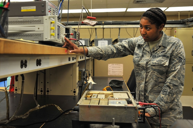 U.S. Air Force Airman 1st Class Darricka Sides, 20th Operations Support Squadron airfield systems technician, sets up a signal generator for radio receiver tuning at Shaw Air Force Base, S.C., Oct. 4, 2017.