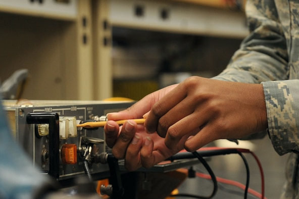 U.S. Air Force Airman 1st Class Darricka Sides, 20th Operations Support Squadron (OSS) airfield systems technician, adjusts a radio receiver for audio cut-off levels at Shaw Air Force Base, S.C., Oct. 4, 2017.