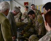 U.S. Air Force Airmen describe weapons and support equipment utilized by 321st Special Tactics Squadron Air Commandos to local high sheriffs, Oct. 13, 2017, on RAF Mildenhall, England. High sheriffs are appointed for one year as active and supportive community leaders in relations to emergency responders, public and volunteer sector organizations involved in crime reduction and social cohesion. Three members of the Office of High Sheriffs toured both RAF Mildenhall and RAF Lakenheath. (U.S. Air Force photo by Senior Airman Justine Rho)