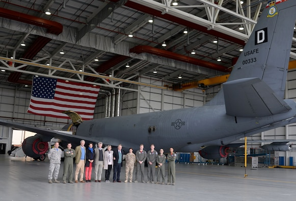 Team Mildenhall leadership, Airmen and local high sheriffs pose for a group photograph in front of a 100th Air Refueling Wing KC-135 Stratotanker Oct. 13, 2017, during a base tour of RAF Mildenhall, England. The community leaders were given the opportunity to speak to Airmen and learn about their career fields. (U.S. Air Force photo by Senior Airman Justine Rho)