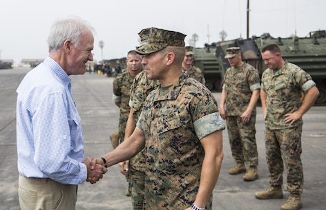 Secretary of the Navy Richard V. Spencer shakes hands with Sgt. Maj. Max Garcia, sergeant major of 3rd Assault Amphibian Battalion, 1st Marine Division at Marine Corps Base Camp Pendleton, Calif., August 30, 2017. Spencer also toured other I MEF units and met with I MEF leadership during his visit. (U.S Marine Corps photo by Lance Cpl. Justin E. Bowles)