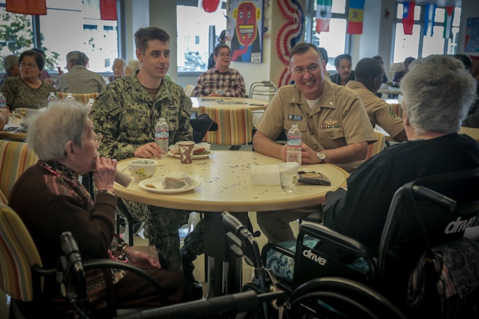 U.S. Marines and Sailors with Combat Logistics Battalion 11, Headquarters Regiment, 1st Marine Logistics Group joined senior citizens at the Mercy Housing, Mission Creek Senior Community Oct. 3, 2017, in San Francisco during San Francisco Fleet Week. The Marines spent time with the senior citizens, participating in activities with them such as bingo, bowling and Nintendo Wii.(U.S. Marine Corps photo by Lance Cpl. Gabino Perez)